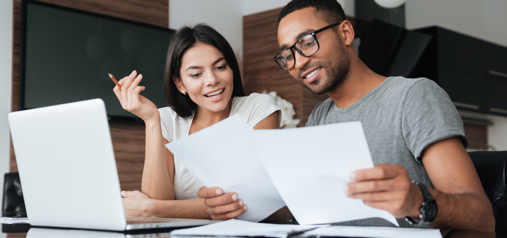 Man and Woman Reviewing Finances